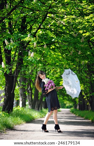 woman with white umbrella in the park. - stock photo