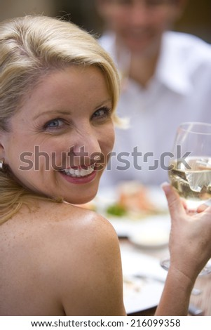 Woman with wine in restaurant, portrait - stock photo