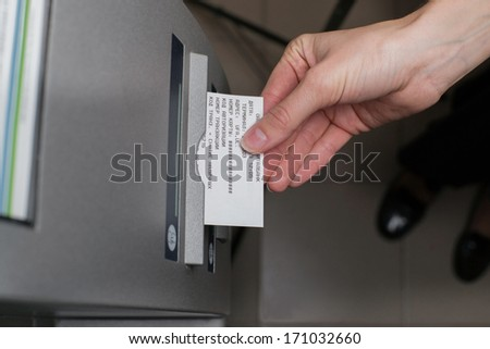 Woman withdrawing chek at ATM - stock photo