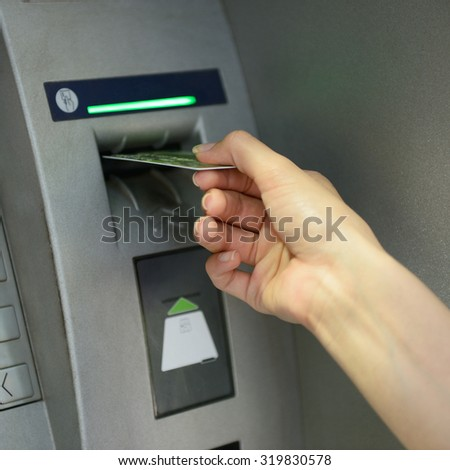 Woman withdrawing money from credit card at ATM. Cash machine. - stock photo
