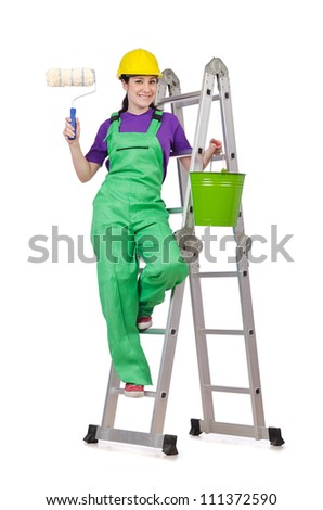 Woman worker standing on ladder - stock photo