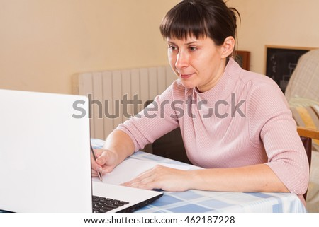 woman working at a laptop at home
