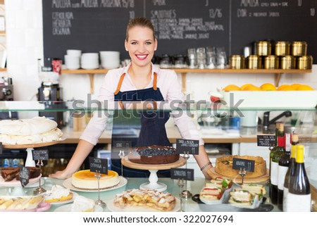 Woman working at cafe - stock photo
