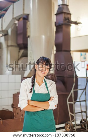 woman working at factory - stock photo