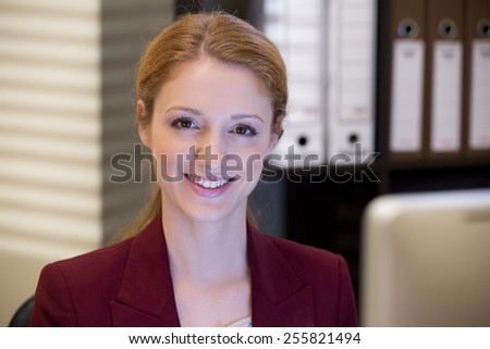 Woman working at the computer - stock photo