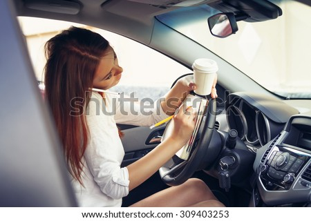 Woman working at the wheel in the car
