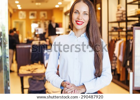woman working in a fashion shop - stock photo
