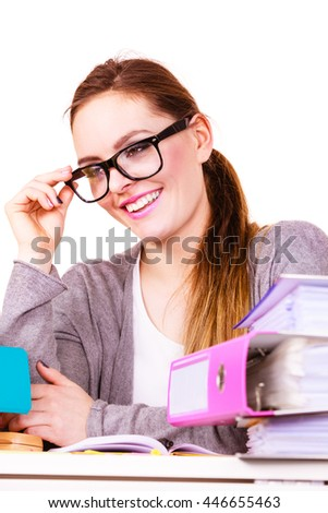 Woman working in office. Positive businesswoman or secretary with many documents folders bills on her desk working. College, workplace education concept.