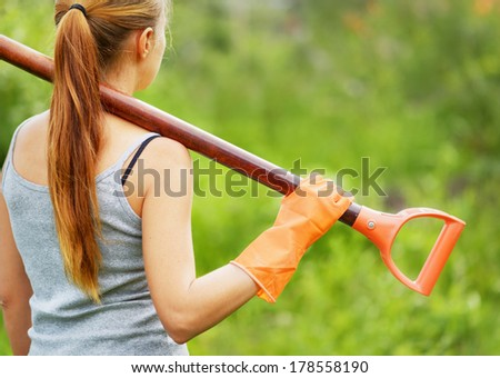 Woman working in the garden. - stock photo