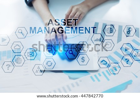 Woman working in the offic, Using modern tablet pc and selecting Asset management.