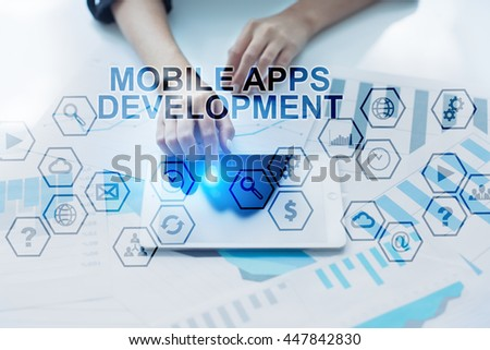 Woman working in the offic, Using modern tablet pc and selecting Mobile Apps development.. - stock photo