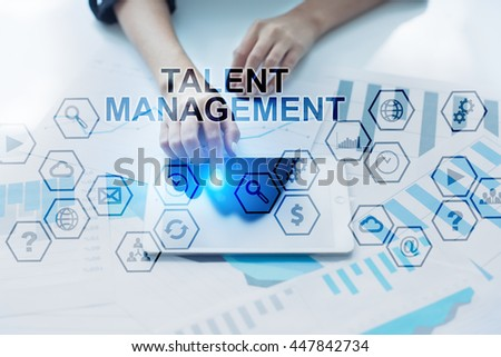 Woman working in the offic, Using modern tablet pc and selecting Talent management..