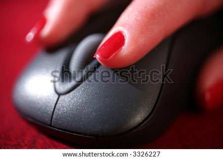 woman working on computer with mouse