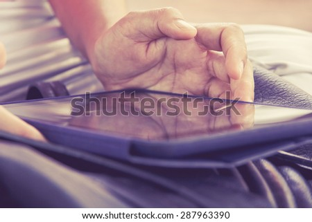 Woman working on digital tablet  - stock photo