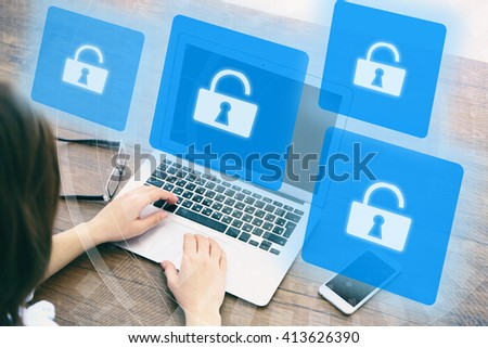 Woman working on laptop with icons security on virtual display. Technology, internet and networking concept. - stock photo