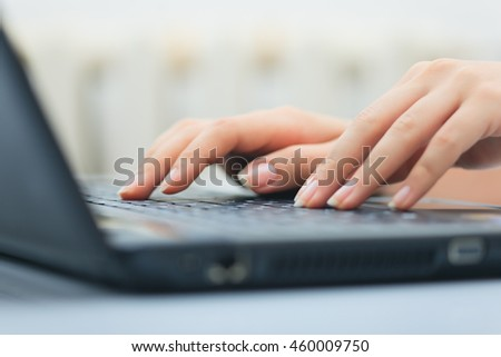 Woman working on the laptop at home