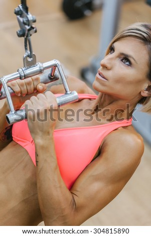 Woman Working out in the Gym - stock photo