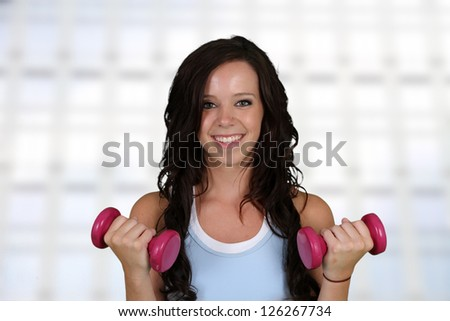 Woman working out while at the gym - stock photo