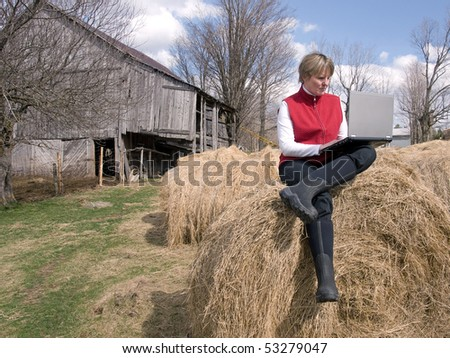 woman working wireless in the country - stock photo