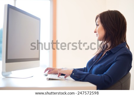 Woman working with computer on her desk