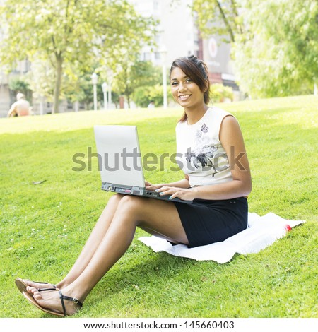 Woman Working with Computer Sitting in the Park.