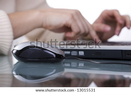 woman working with her laptop at the office (selective and soft focus)