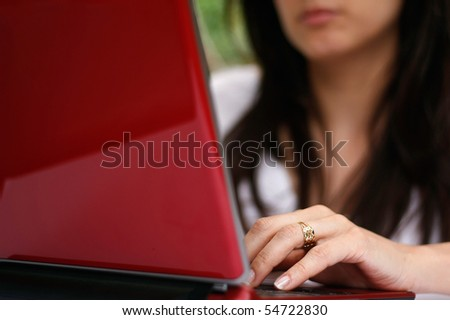 Woman working with laptop - stock photo