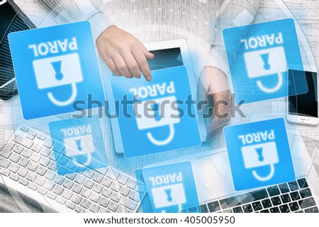Woman working with tablet-pc and icons security on virtual display. Technology, internet and networking concept. - stock photo