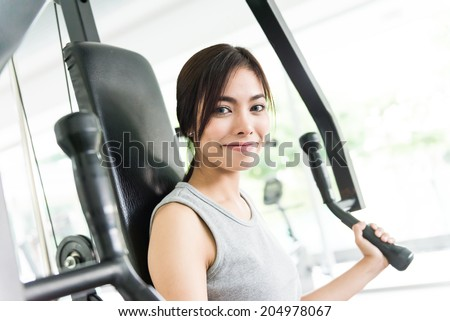 Woman workout at fitness gym
