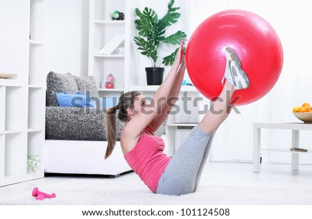 Woman workout fitness posture abdominals push-ups with fitness ball - stock photo