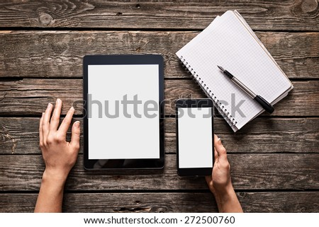 Woman works using digital devices. Above view of desktop workspace. Both clipping paths included.