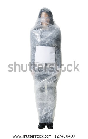 Woman wrapped in bubble wrap with blank sign