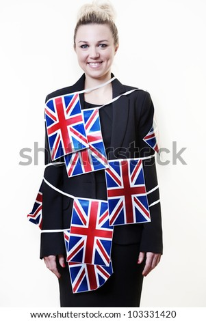 woman wrapped up in british flag bunting - stock photo