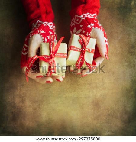 Woman wrapping christmas gift - stock photo