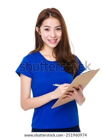 Woman write on clipboard - stock photo
