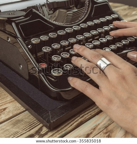 woman writer in the process of writing a new bestseller. Toned tinted filtered square photo instagram retro vintage style - stock photo