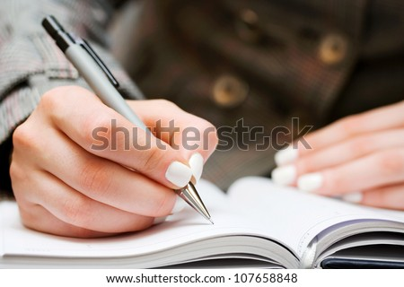 Woman writing - stock photo