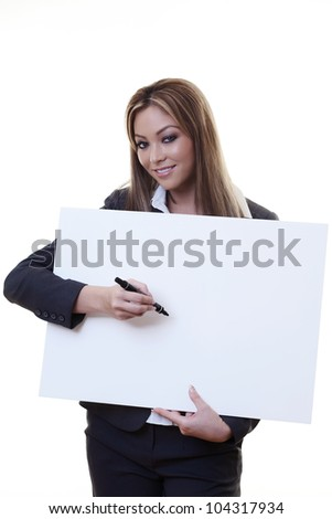 woman writing something on a large white board