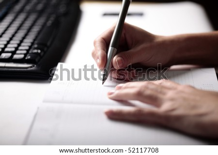 "Woman writing ""to do list"""