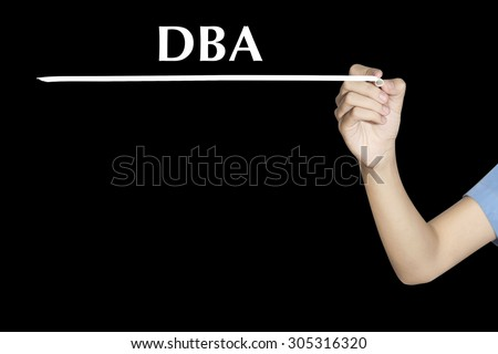 Woman writing word DBA (or Database Administrator) with black screen