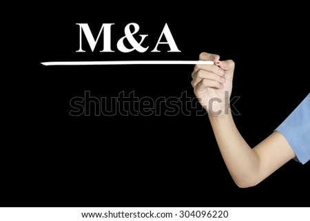 Woman writing word M&A (Merger and Acquisition) with black screen - stock photo