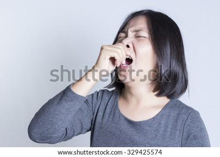 Woman Yawning Isolated on White Background - stock photo