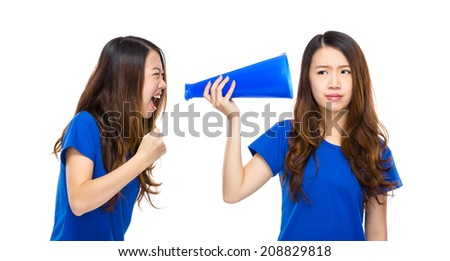 Woman yell to other with megaphone - stock photo