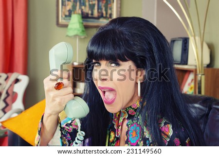 Woman yelling into phone with bad connection - stock photo
