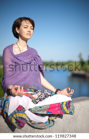 woman yoga meditation outdoors - stock photo