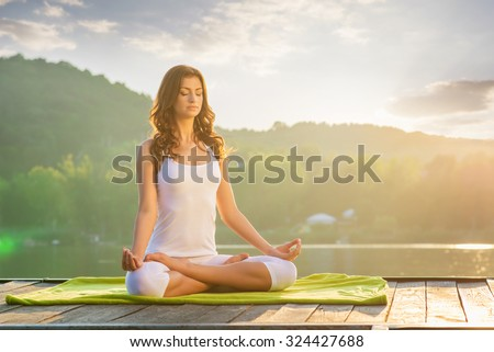 Woman Yoga - relax in nature - stock photo