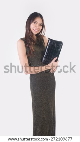 Woman. young asian woman hold clutch on the background