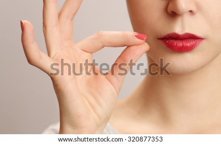 Woman zipping her mouth shut - keeping quiet concept