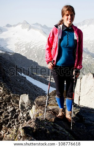 Womanhiker in the mountains - stock photo
