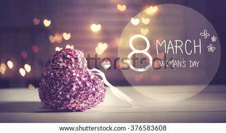 Womans Day message with pink heart with heart shaped lights - stock photo